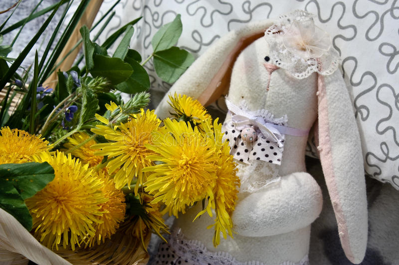 Basket with dandelions and rabbit stock images