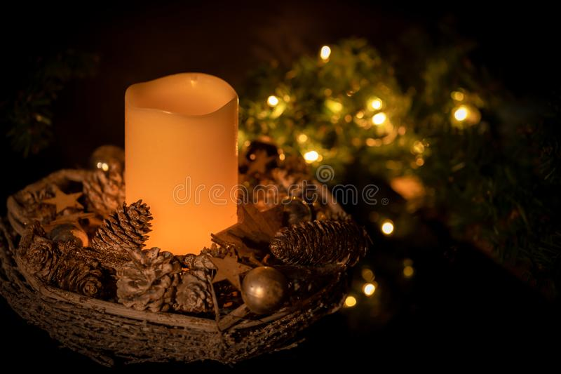 Basket with decorative items and a candle stock photo