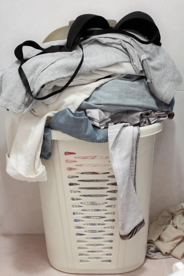 Basket dirty laundry in the bathroom. Photo stock photo