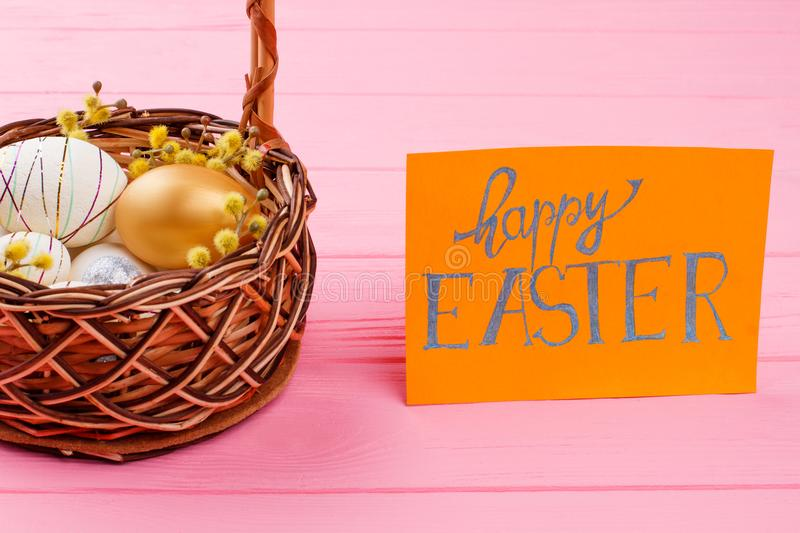 Basket with festive Easter eggs. royalty free stock image