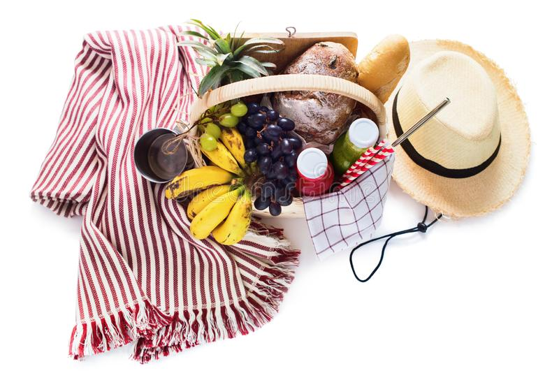 Basket filled food fruit striped plaid Picnic summer royalty free stock photo