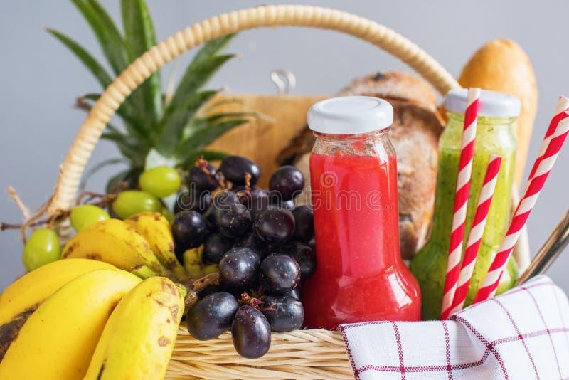 Basket filled food fruit striped plaid Picnic summer stock photo