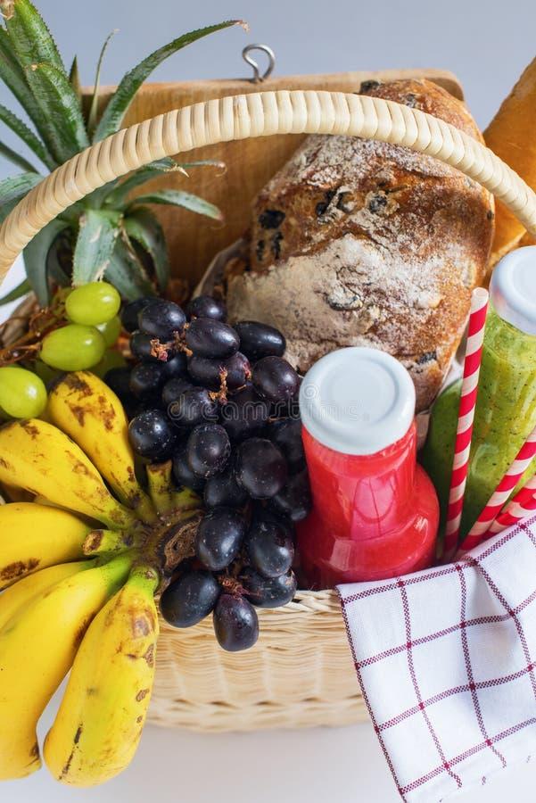 Basket filled food fruit striped plaid Picnic summer stock photos