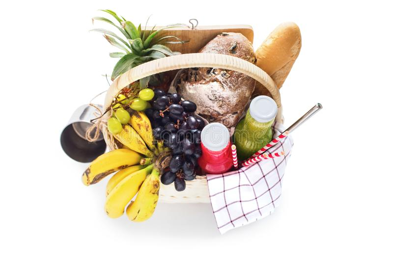 Basket filled food and fruits for picnic summer stock image