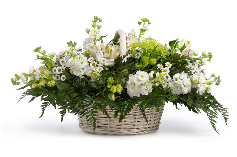 Basket with flowers. Isolated on white stock photos