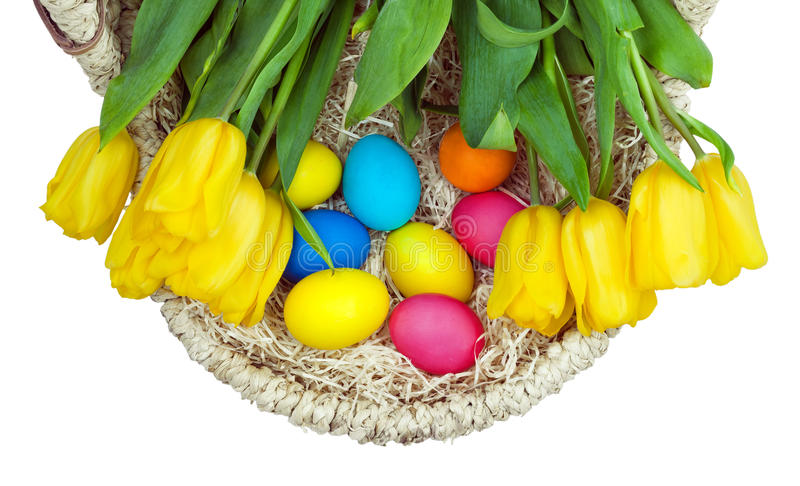 The basket with flowers and Easter eggs stock image