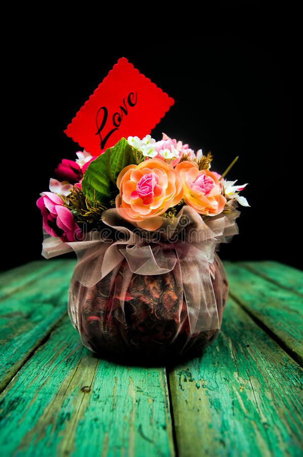 Basket with flowers. On a wooden background stock photos