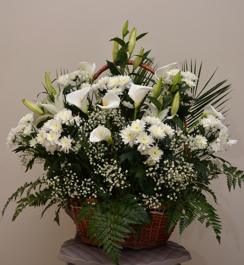 Basket of Flowers. Basket with flowers, white calla lilies chrysanthemums royalty free stock images