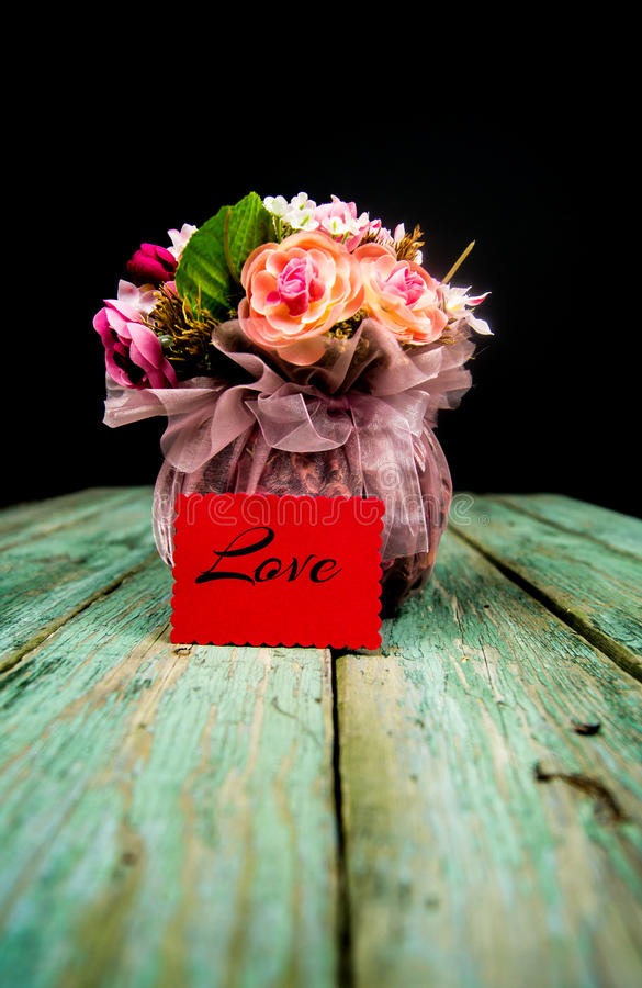 Basket with flowers. On a wooden background royalty free stock photo
