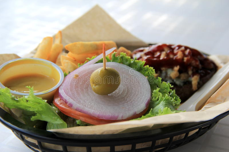 Basket of french fries and blue cheese burger royalty free stock images