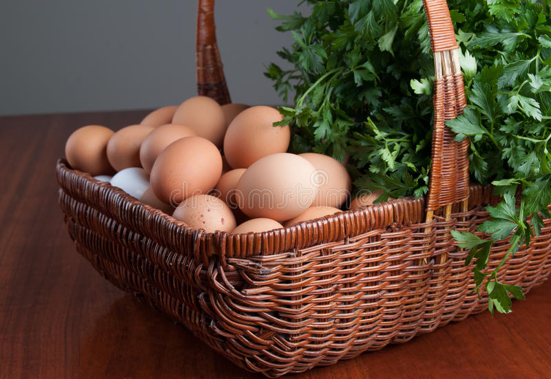 Basket with fresh eggs and herbs royalty free stock photo