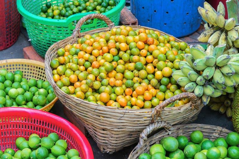 Basket of fresh tangerines in street market Can Tho Vietnam. Basket of fresh tangerines at the counter in the street market in Can Tho, in Vietnam royalty free stock photo