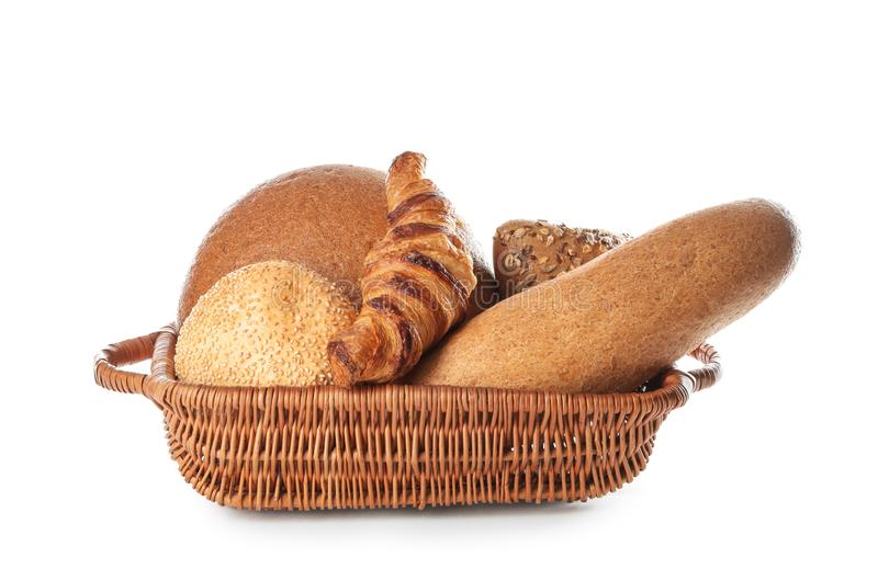 Basket with freshly baked bread products on white background stock photo