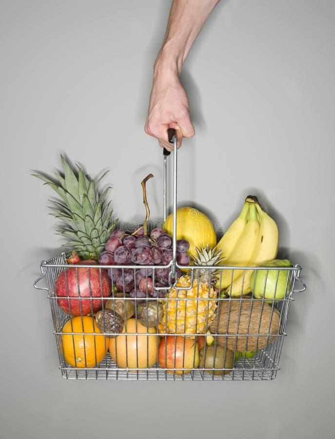 Basket of fruits. Apple background bag bananas basket fruit grey healthy kiwi lime melon orange passion pick pineaplle several shopping vindruvor vitamines stock photo