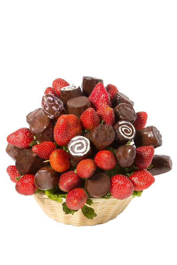 Basket with fruits and berries in chocolate isolated on white background. Handmade. Strawberries and bananas in. Chocolate. Gift basket for Valentine`s Day stock photos