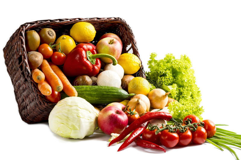 Basket with fruits and vegetables on a white background stock photos