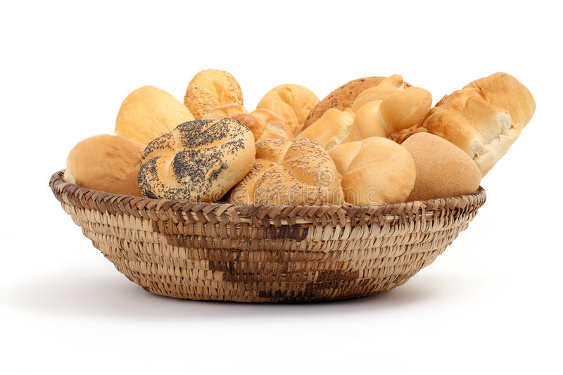 Basket full of bread on a white table royalty free stock photo