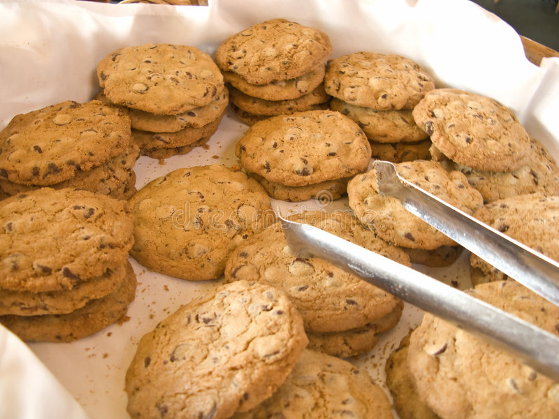 Basket full of Cookies. At Brunch with Tongs stock image
