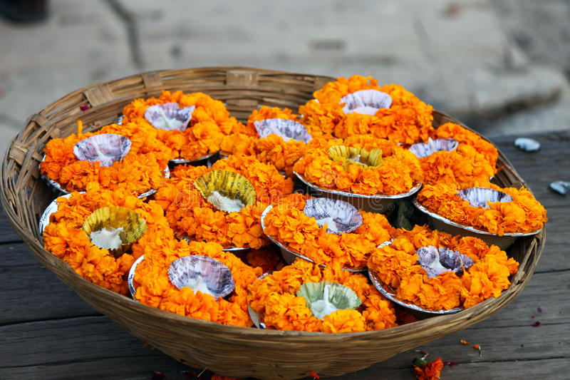 A basket full of flower pots and candles in Varanasi, India royalty free stock photos