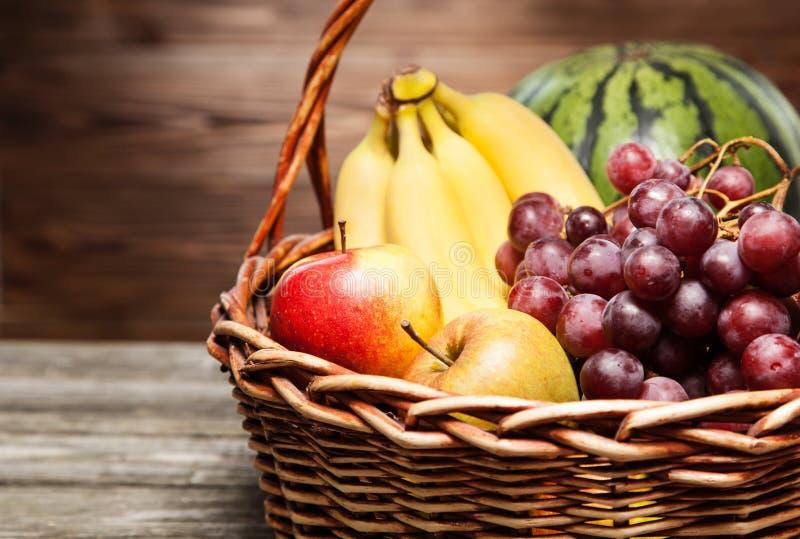 Basket full of fresh fruit stock photo