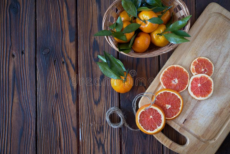 Basket full of tangerines and Christmas dried orange slice ornaments royalty free stock image