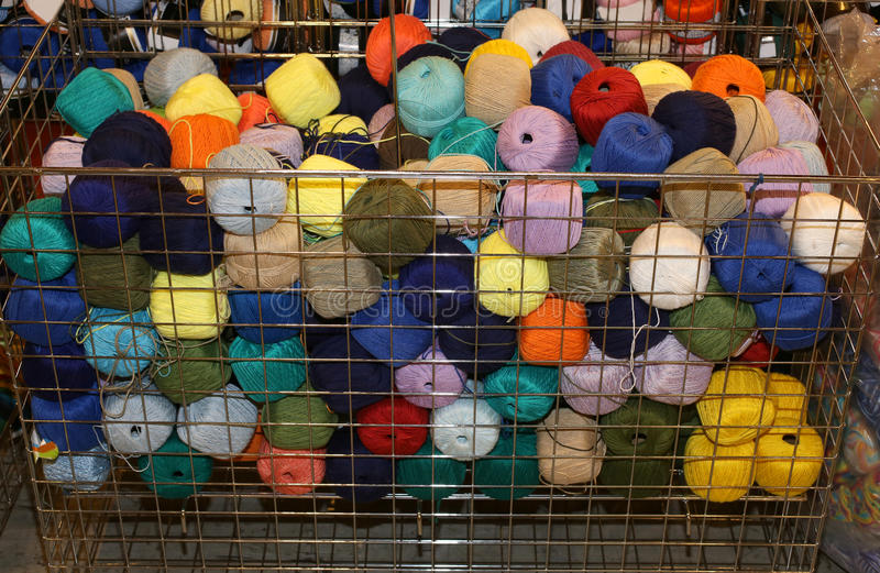 Basket full of woolen yarns for sale in wholesale haberdashery royalty free stock photo