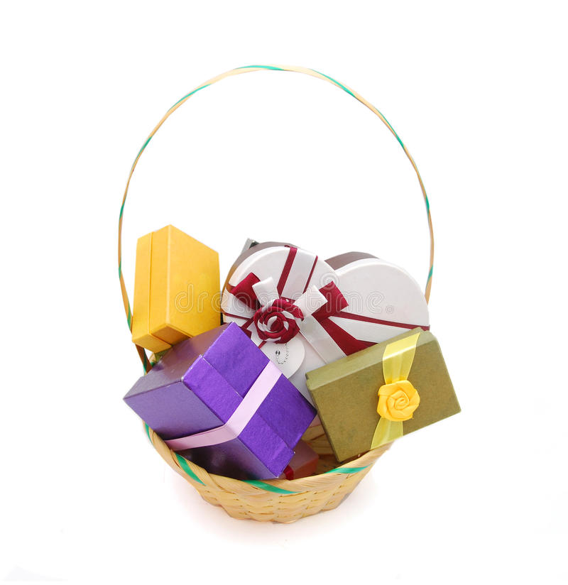 Basket gift boxes. Basket with Colour gift boxes isolated on white royalty free stock photography