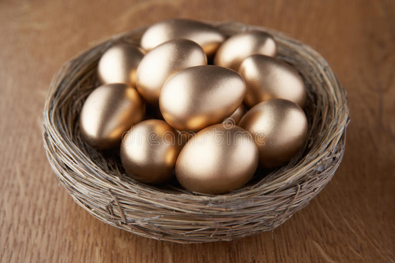 Download A basket of golden eggs stock photo. Image of saving - 17450546
