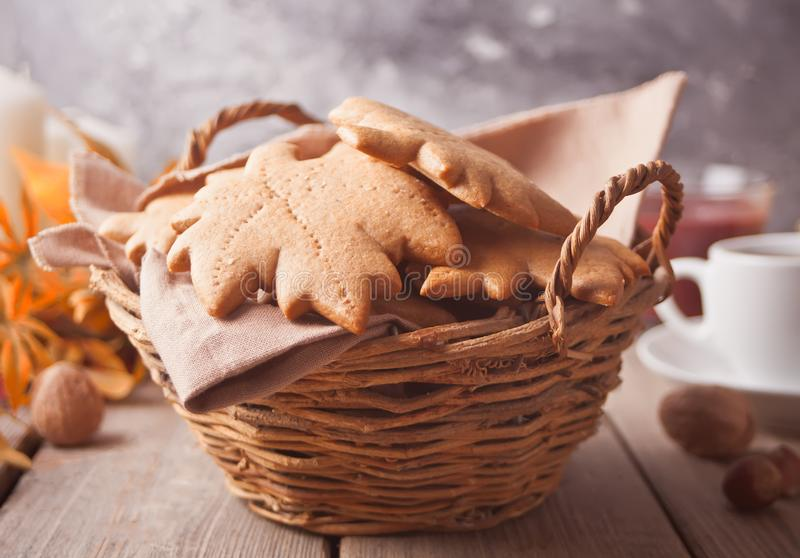 Basket with homemade cookies, cuop of coffee, leaves on the wooden table. Autumn harvest. Autumn concept. Top view stock image