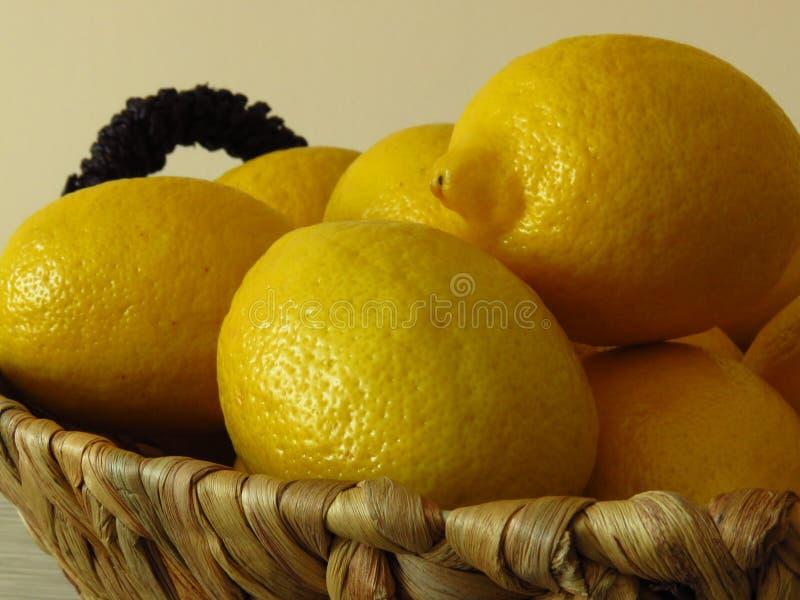 A basket of juicy ripe yellow lemons. Healthy tropical fruit rich of vitamin C. Healthy organic lemons. stock images