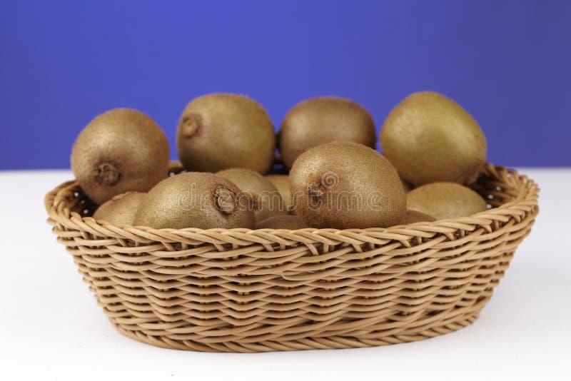Basket of kiwis stock images