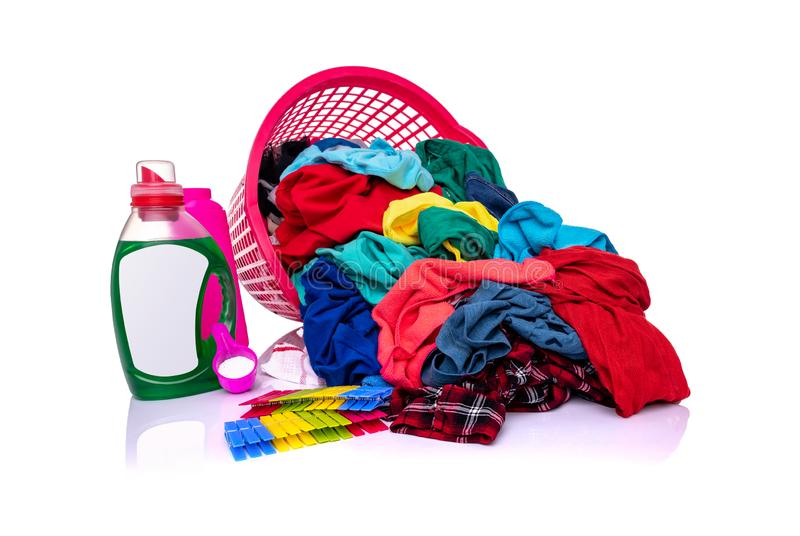 A basket with laundry on a white background. stock photography
