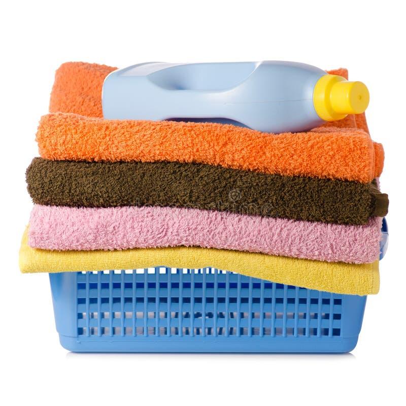 Basket with laundry towels bottle liquid powder. On white background isolation royalty free stock photo