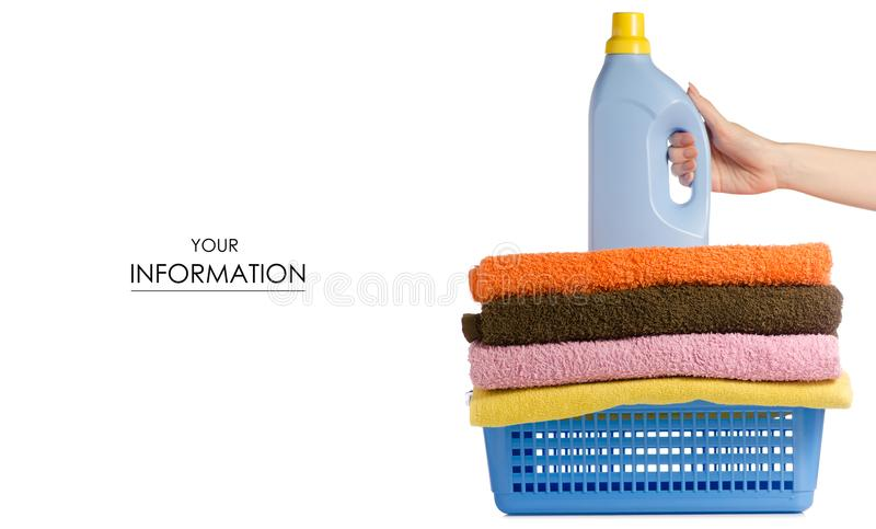 Basket with laundry towels liquid bottle powder conditioner softener in hand pattern royalty free stock photos