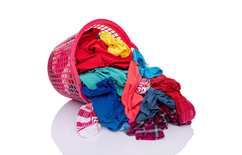 A basket with laundry on a white background. royalty free stock images