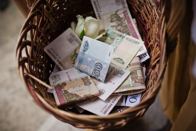 Basket of money stock photography