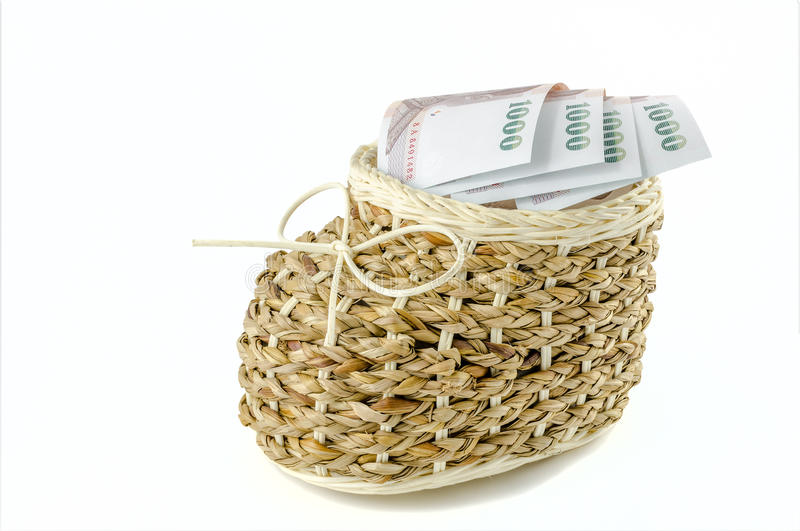 Basket with money on isolated background. Basket with money on isolated white background royalty free stock images