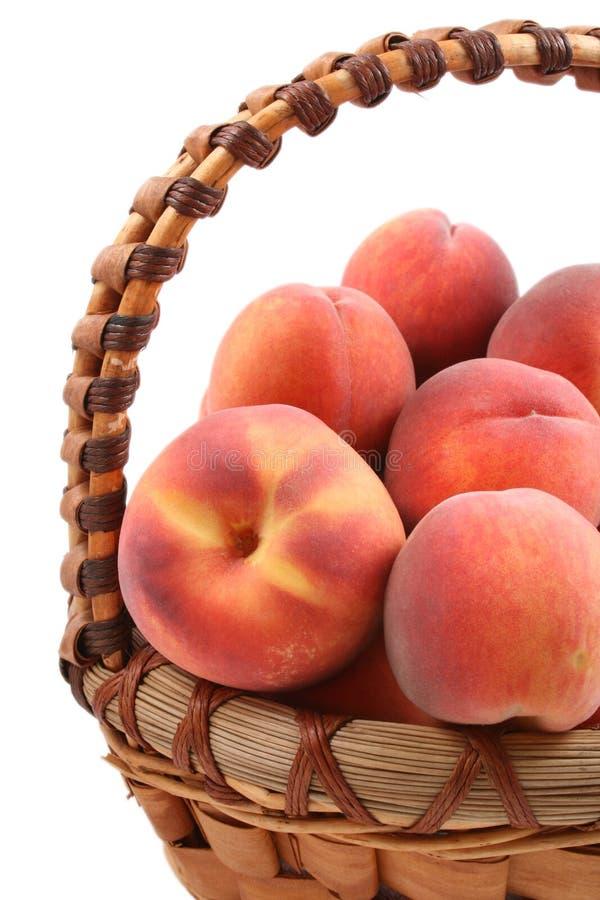 Basket of peaches royalty free stock photos