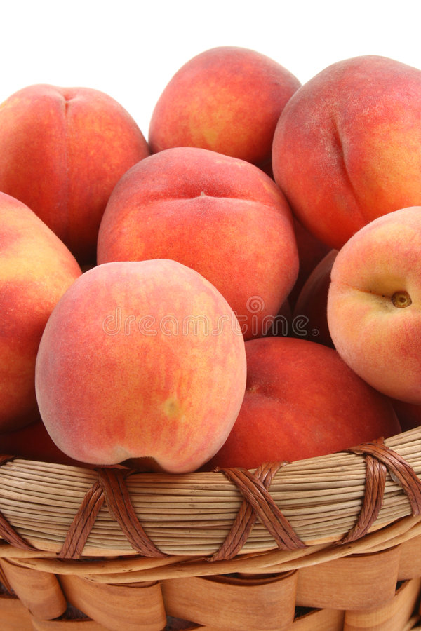 Basket of peaches royalty free stock image