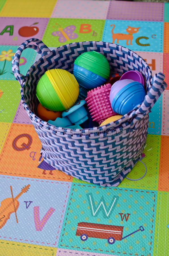 Basket with colorful toys royalty free stock image