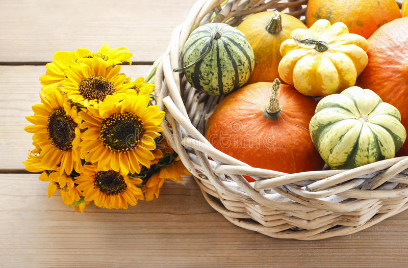 Basket Of Pumpkins On Wooden Table Stock Photo