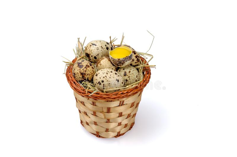Basket with quail eggs on a white background royalty free stock photography