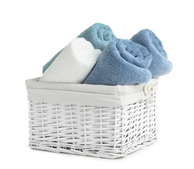 Basket with rolled towels. Isolated on white royalty free stock photos