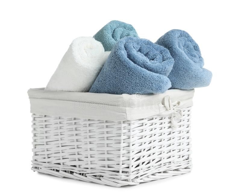 Basket with rolled towels. Isolated on white royalty free stock photography