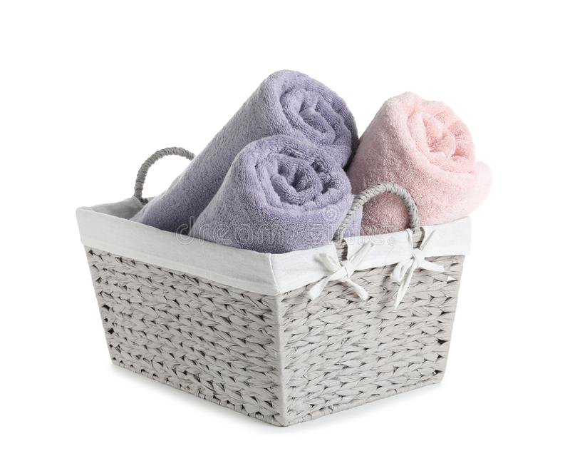Basket with rolled towels. Isolated on white stock photos