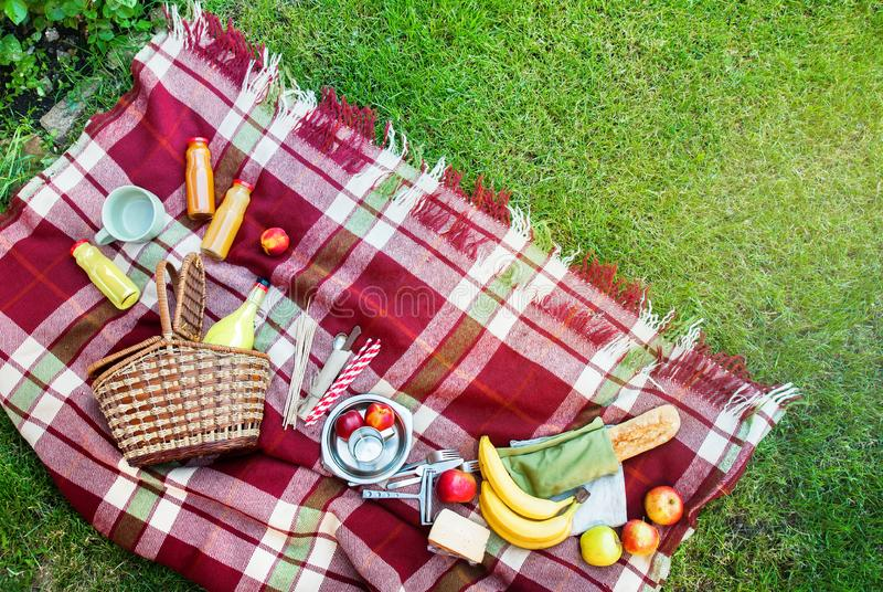 Basket Setting Food Fruit Checkered Plaid Picnic Grass. Summer Time Rest Background Top View stock image