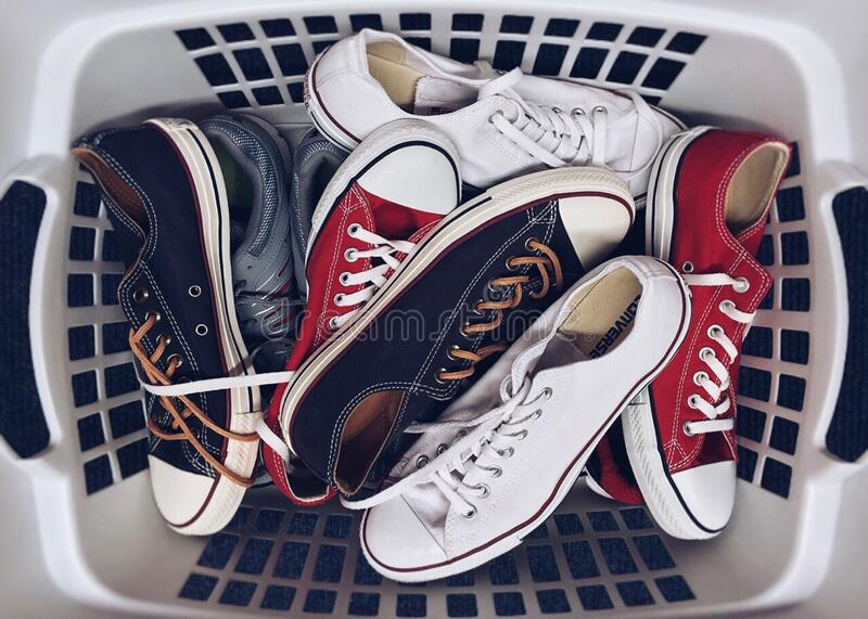 Basket with sneakers royalty free stock photo