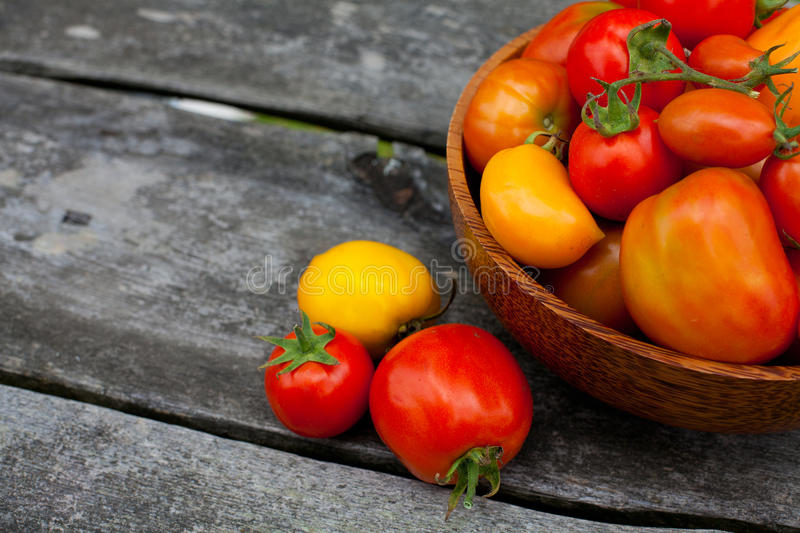 Basket With Tomatoes Stock Images