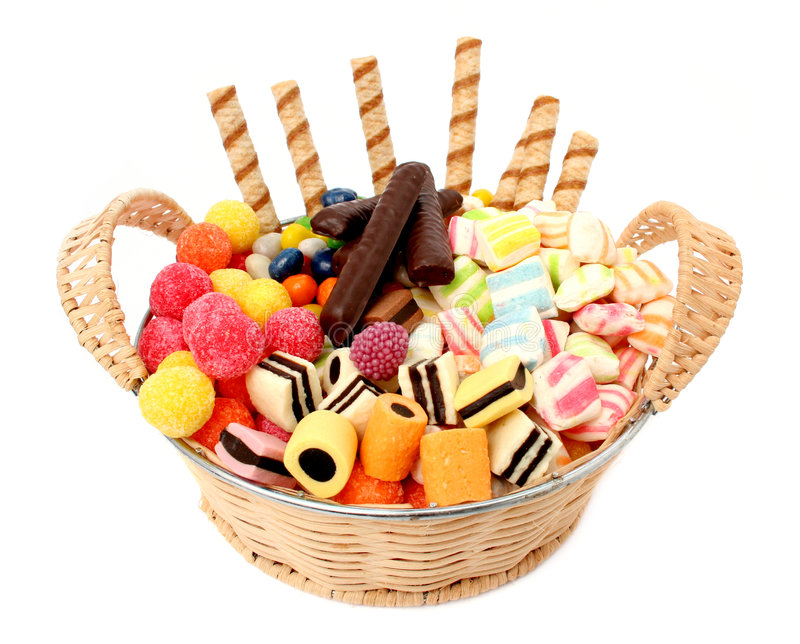Basket with various sweets and the cookies, isolated stock images