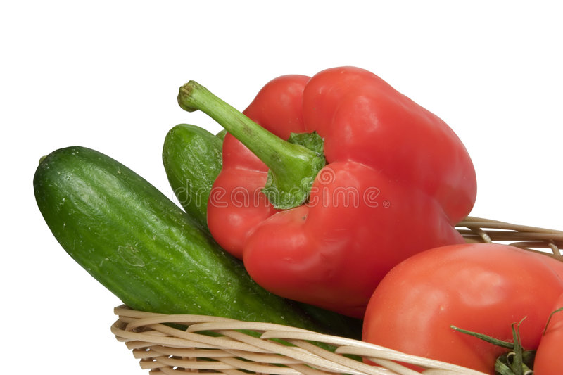 Basket with vegetables. On white background with clipping path stock photography